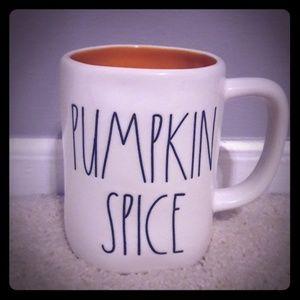 Rae Dunn PUMPKIN SPICE mug with orange inside.